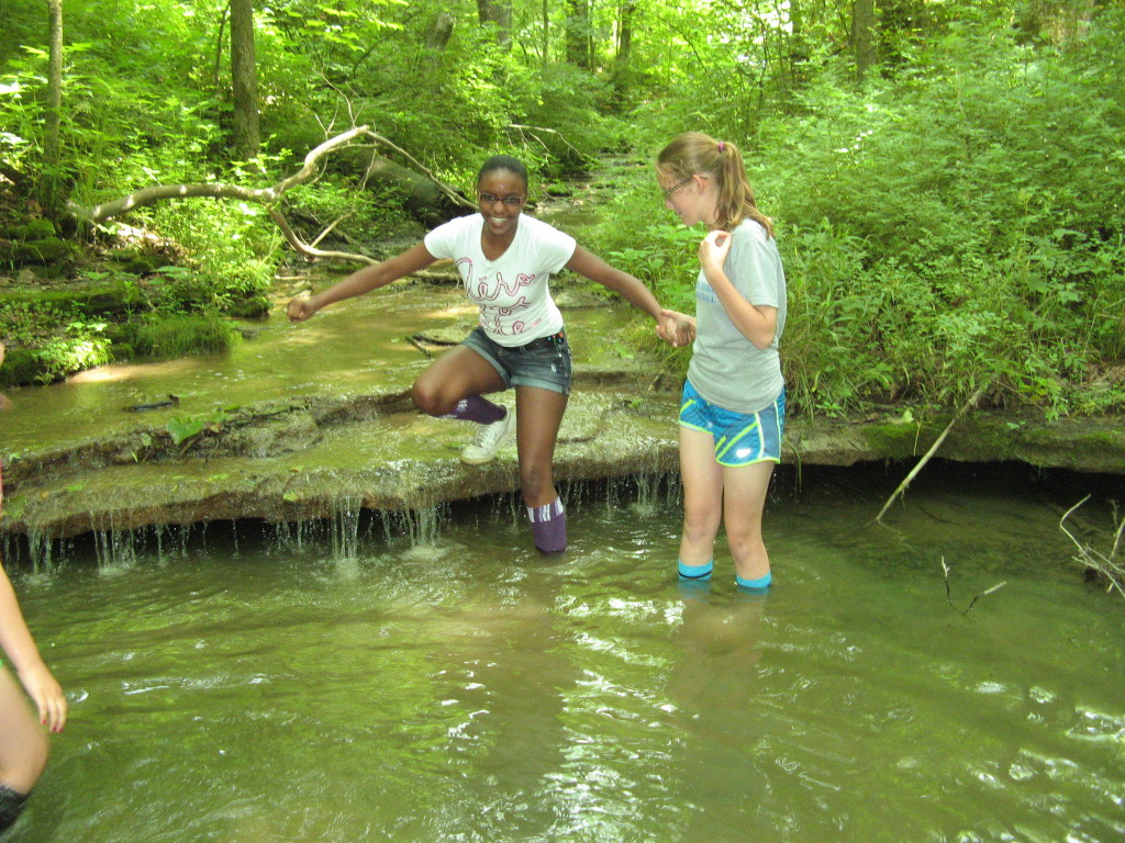 Local youth explore the waterfall area on the southeast side of the property