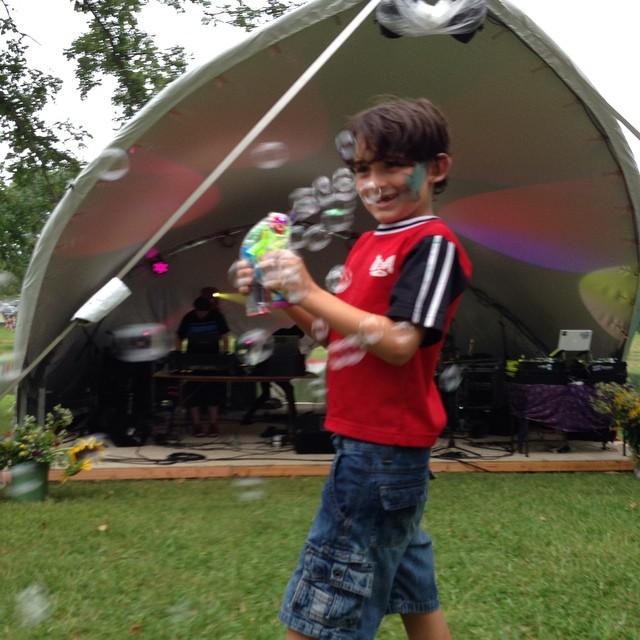 Boy blasting concertgoers at Prophets Fest 2014
